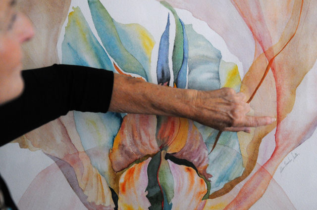 Artist Eileen Raucher-Sutton, who has professionally painted artwork since 1970 in New York, talks about her work during a tour of her home studio in Henderson, June 25. (Erik Verduzco/View)