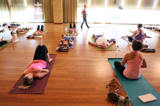 Tiffany DeLong, back center, teaches a yoga class at Life Time Athletic, located at 10721 W. Charleston Blvd., Wednesday, June 18, 2014, in Las Vegas. Life Time Athletics opened in 2011 and plans  ...