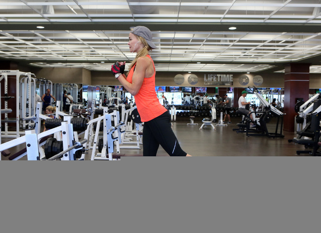 Michele Lacey (cq) works out at Life Time Athletic, located at 10721 W. Charleston Blvd., Wednesday, June 18, 2014, in Las Vegas. Life Time Athletics opened in 2011 and plans to expand in the Gree ...