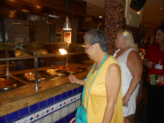 Two members of the Valley Health System's Senior Advantage 55+ Program, Pauline Lau, left, and Laura Leigh Mikula, right, peruse lunch options July 9 at the Suncoast's St. Tropez Buffet. They we ...