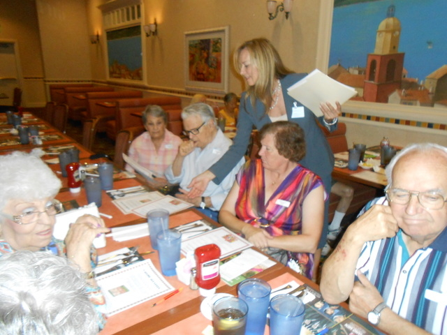 Holly Angotti, physician liaison, hands out tip sheets July 9 to members of Valley Health System's Senior Advantage 55+ Program at the Suncoast, 9090 Alta Drive. Fifty members and guests signed  ...