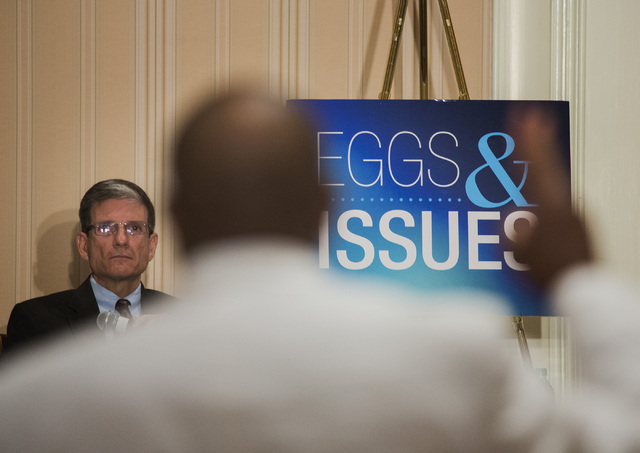 """U.S. Rep. Joe Heck, R-Nev., listens while Bobby Haynes asks him a question during the Las Vegas Metro Chamber of Commerce """"Eggs & Issues"""" breakfast at the Four Seasons on Tuesday, July 1, 2014. He ..."""