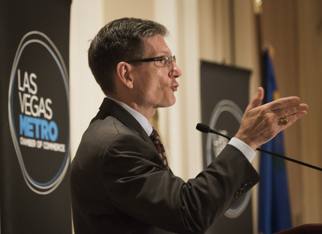 """U.S. Rep. Joe Heck, R-Nev., speaks during the Las Vegas Metro Chamber of Commerce """"Eggs & Issues"""" breakfast at the Four Seasons on Tuesday, July 1, 2014. Heck updated the group on the latest bills ..."""