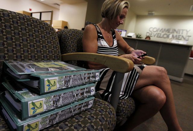 Debra Freeman waits her turn to apply for a medical marijuana establishment in the Community Development office at Henderson City Hall on July 17, 2014. (Jason Bean/Las Vegas Review-Journal)