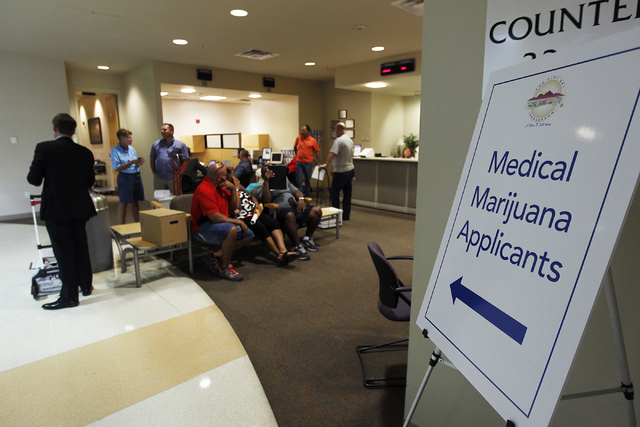 People gather to apply for medical marijuana establishments in the Community Development office at Henderson City Hall on July 17, 2014. (Jason Bean/Las Vegas Review-Journal)
