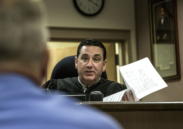 Clark County Family Court Judge William Voy speaks to Bruce Burgess, superintendent of Caliente Youth Center, during a hearing  at  Family Courts and Services Center on Thursday, July 24, 2014. Ju ...