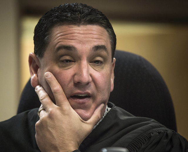 Clark County Family Court Judge William Voy speaks  on Thursday, July 24, 2014 at  Family Courts and Services Center during  a hearing involving juvenile hogtying incidents. Judge Voy  removed Cla ...