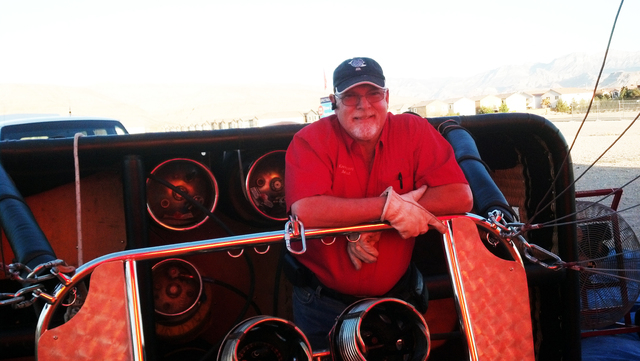 Hot air balloon pilot and Love is in the Air Ballooning LLC owner/operator Kevin Cloney gets ready to fire up the burner in this undated photo. His company has refitted one of its three balloons w ...
