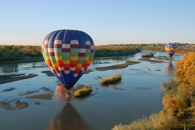 A Love is in the Air-owned hot air balloon flys over the Rio Grande in this undated photo. (Special to View)