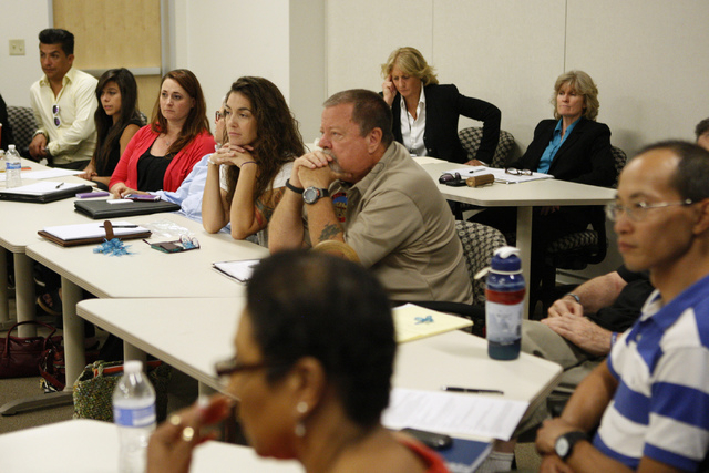 People listen to a project presentation during a Mayor's Faith Initiative Workgroup meeting on human trafficking at Las Vegas City Hall in Las Vegas Thursday, July 24, 2014. (Erik Verduzco/Las Veg ...
