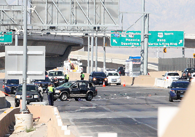 One child is dead and another person has critical injuries after a single-vehicle rollover accident on northbound Interstate 15 near the D Street exit in Las Vegas on Wednesday, July 2, 2014. Seve ...