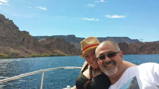 Jorge Luna, 53, and his girlfriend, Tonja Sweeney, on his rental boat last Sunday before he leaped off to go swimming. (Courtesy Photo)