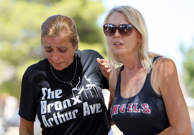 Julie Ramos, left, stands with her sister Kim Johnston outside Ramos' home during a news conference on Autumn Street Wednesday, July 30, 2104, in Las Vegas. The Ramos family called a news c ...