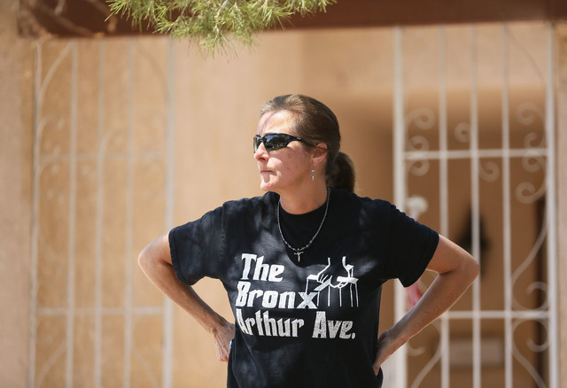 Julie Ramos looks off while standing in front of her home prior to speaking during a news conference on Autumn Street Wednesday, July 30, 2104, in Las Vegas. The Ramos family called a news confere ...