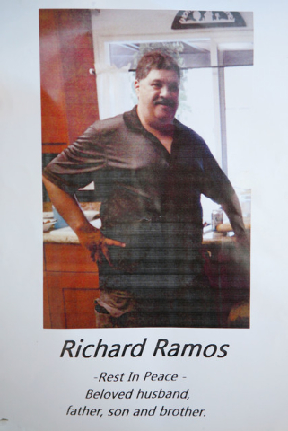 A flyer provided by the Ramos family of Richard Ramos Wednesday, July 30, 2104, in Las Vegas. The Ramos family called a news conference for Julie's husband Richard, who was killed during a home in ...