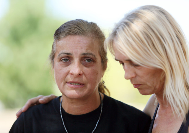 Julie Ramos, left, stands next to her sister Kim Johnston outside Ramos' home and speaks during a news conference on Autumn Street Wednesday, July 30, 2104, in Las Vegas. The Ramos family c ...