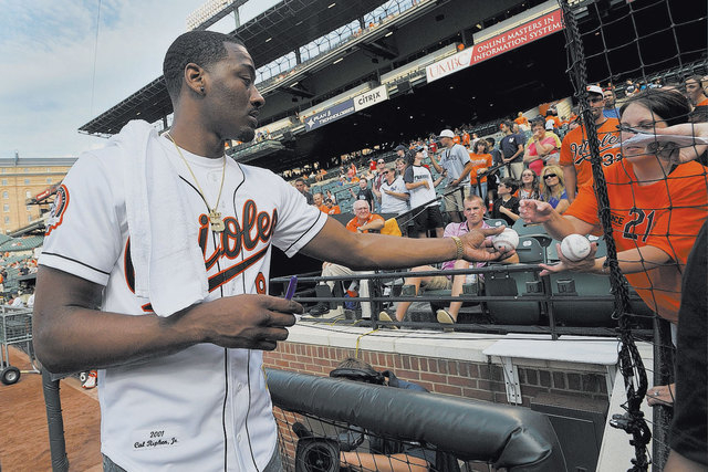 360950fd3aec NBA player John Wall of the Washington Wizards signs autographs before a  baseball game between the