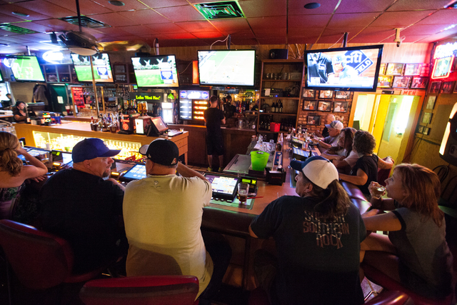 People sit at the bar area at Johnny Mac's, 842 S. Boulder Highway, in Henderson on Saturday, July 5, 2014. (Chase Stevens/Las Vegas Review-Journal)
