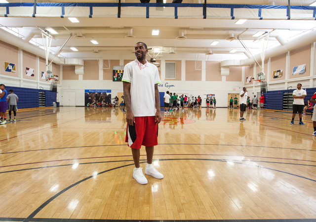 Indiana Pacers guard C.J. Watson stands on the court after refereeing a game during the Hoops for Hope basketball camp, held by the Quiet Storm Foundation at Doolittle Community Center, 1950 J Str ...