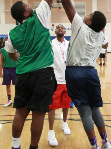 Indiana Pacers guard C.J. Watson watches the action after throwing the jump ball during the Hoops for Hope basketball camp, held by the Quiet Storm Foundation at Doolittle Community Center, 1950 J ...