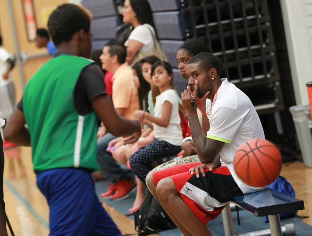 Indiana Pacers guard C.J. Watson watches the action during the Hoops for Hope basketball camp, held by the Quiet Storm Foundation at Doolittle Community Center, 1950 J Street, in Las Vegas on Frid ...