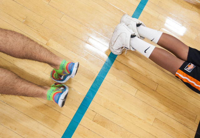 People do push-ups during the Hoops for Hope basketball camp, held by the Quiet Storm Foundation at Doolittle Community Center, 1950 J Street, in Las Vegas on Friday, July 18, 2014. The Quiet Stor ...
