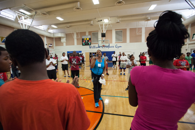 Cathy Watson, mother of Indiana Pacers guard C.J. Watson, speaks during the Hoops for Hope basketball camp, held by the Quiet Storm Foundation at Doolittle Community Center, 1950 J Street, in Las  ...