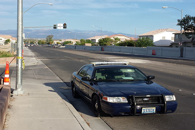 A CCSD police car is seen outside Brookman Elementary School near the 1200 block of Fairchild Street where a woman was pronounced dead. (Kimber Laux/Las Vegas Review-Journal)