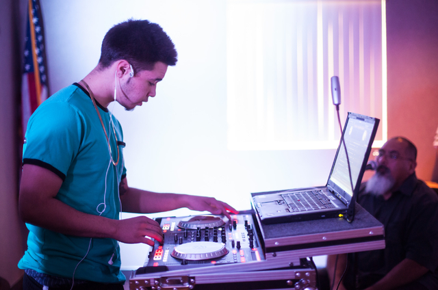 Fabian Babb, 17, DJs  during a Learn to DJ class at Enterprise Library, 25 E. Shelbourne Ave., in Las Vegas on Thursday, July 3, 2014. (Chase Stevens/Las Vegas Review-Journal)