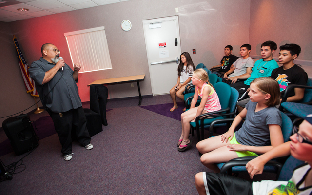 Branch Manager Salvador Avila, left, speaks during a Learn to DJ class at Enterprise Library, 25 E. Shelbourne Ave., in Las Vegas on Thursday, July 3, 2014. (Chase Stevens/Las Vegas Review-Journal)