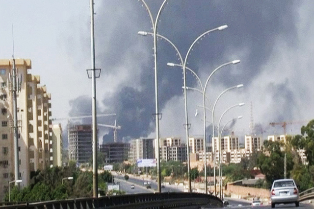 n this Sunday, July 13, 2014 file image made from video by The Associated Press, smoke rises from the direction of Tripoli airport in Tripoli, Libya.  (AP Photo/File)