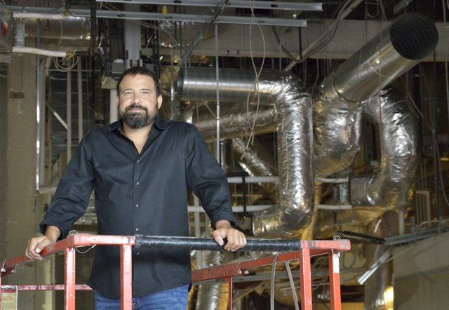 Andy Masi, CEO of The Light Group, is shown on the construction site for Hearthstone Kitchen and Cellar, which is being developed by The Light Group at the Red Rock Resort at 11011 W. Charleston B ...