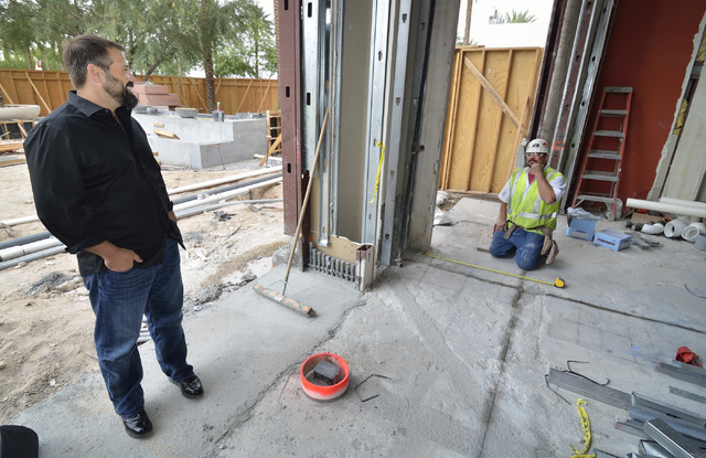 Andy Masi, CEO of The Light Group, left, talks with general foreman Clint Bergquist on the construction site for Hearthstone Kitchen and Cellar, which is being developed by The Light Group at the  ...