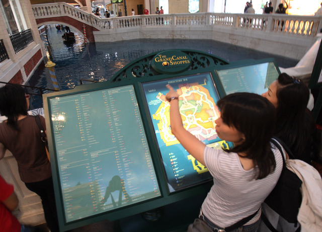 Visitors at the Grand Canal Shoppes at the Venetian Macau on Sept. 11, 2007. The mall will eventually have 350 shops. Gambling revenue from Macau's 35 casinos fell to $3.4 billion in June, accor ...