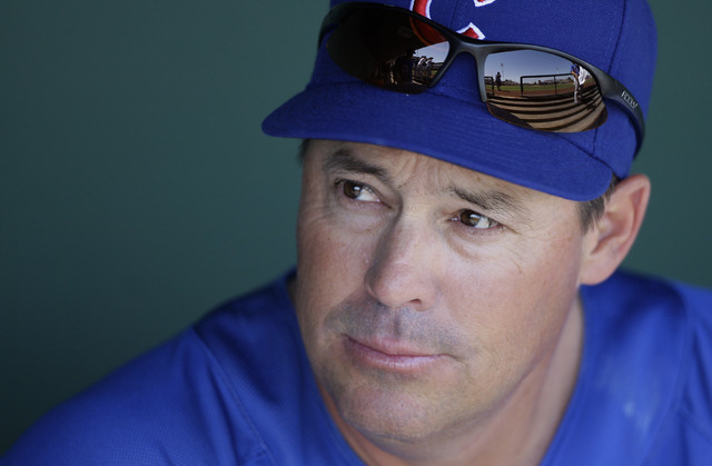 Former Chicago Cubs pitcher Greg Maddux, now assistant to the general manager, before the Cubs played the San Francisco Giants in a spring training baseball game in Scottsdale, Ariz., Tuesday, Mar ...
