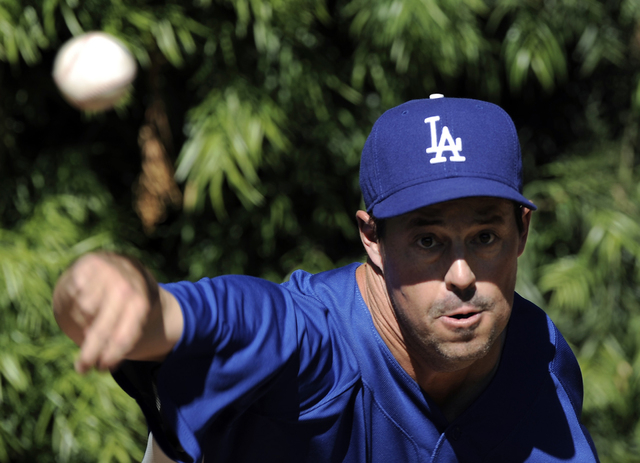Los Angeles Dodgers pitcher Greg Maddux throws in the bullpen during baseball practice in Los Angeles on Monday, Oct. 6, 2008.  The Dodgers face the Philadelphia Phillies in the best-of-seven Nati ...