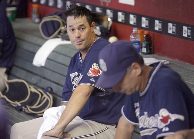 San Diego Padres pitcher Greg Maddux, left, talks with manager Bud Black, right, as the Arizona Diamondbacks take the field in the third inning of a baseball game Monday, Sept. 3, 2007, in Phoenix ...