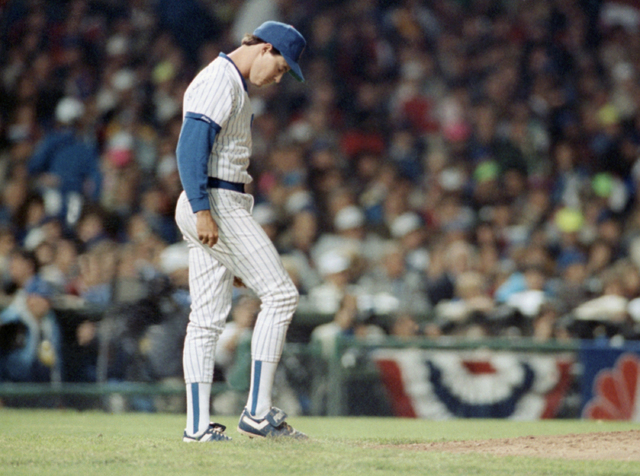 Cubs pitcher Greg Maddux looks down in dejection after San Francisco Giants Will Clark clipped him for a home run in the third inning of the NL playoff game, Wednesday, Oct. 4, 1989, Chicago, Ill. ...