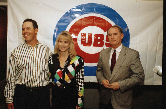 Chicago Cubs pitcher Greg Maddux, left, and wife Kathy talk to reporters at Wrigley Filed in Chicago after Maddux was named the winner of the 1992 National League Cy Young Award, Nov. 11, 1992. (A ...