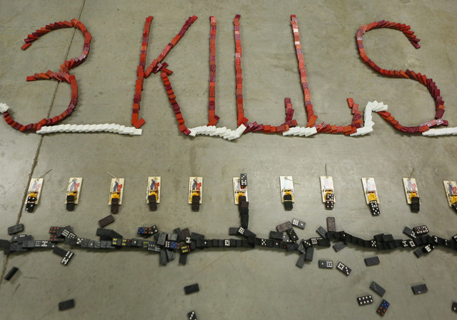 A domino demonstration is shown after the dominoes have fallen during a news conference at Nevada Policy Research Institute Tuesday, July 22, 2014, in Las Vegas. The 3,610 dominoes, which were pla ...