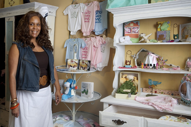 Stephanie Mitchell-Anthony poses with products in her shop Pas de Deux which is located in the Tivoli Village complex at 440 S. Rampart Blvd., on Thursday, July 24, 2014. (Jeferson Applegate/Las V ...