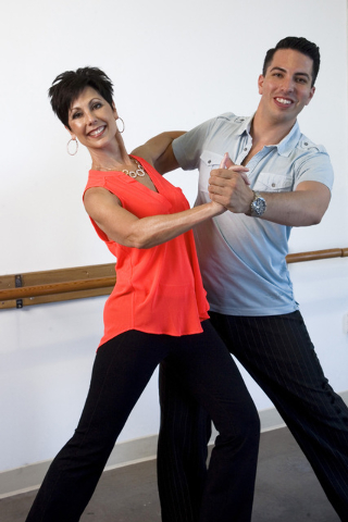 Dana Delgado owner of Dana Delgado Dance demonstrates a dance move with dance instructor Leon Fernandez in her studio located in the Tivoli Village complex at 440 S. Rampart Blvd., as pictured on  ...