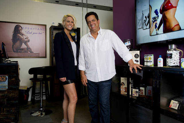 Owner Pamela McPherson Sanders and owner Mark Yacullo pose in his shop SPRAYTANS located in the Tivoli Village complex located at 440 S. Rampart Blvd., on Thursday, July 24, 2014. (Jeferson Appleg ...