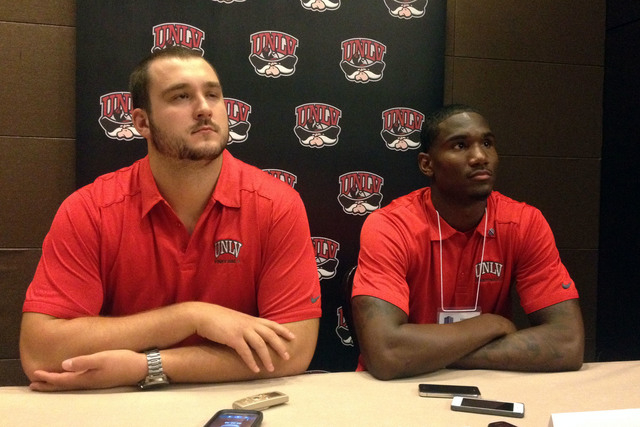 UNLV seniors Brett Boyko and Devante Davis meet with the media on Wednesday during Mountain West media day at the Cosmopolitan.   (Lori Cox/Las Vegas Review-Journal)