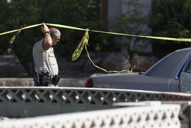 The scene of a home invasion and shooting at the corner of Autumn Street and Rollingwood Drive in Las Vegas Tuesday, July 29, 2014. A home invasion suspect was declared dead at the scene. (Erik Ve ...