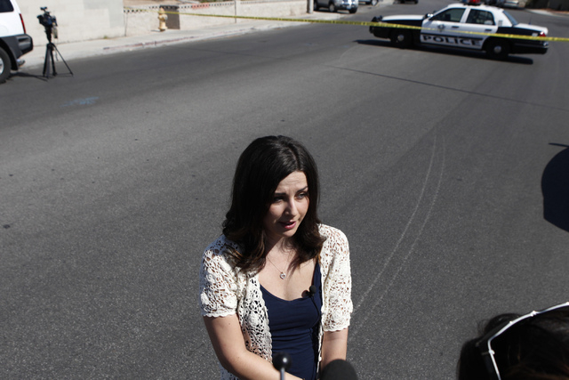 Emily Ogilvie, a neighbor of a home invasion victim, is interviewed at the scene about was she saw at the corner of Autumn Street and Rollingwood Drive in Las Vegas Tuesday, July 29, 2014. A home  ...