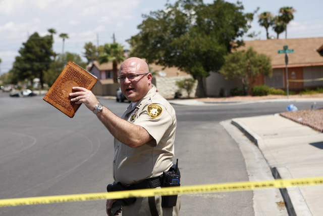 Las Vegas police Capt. Matt McCarthy of the Internal Oversight division speaks to the media at the scene of a home invasion and shooting at the corner of Autumn Street and Rollingwood Drive in Las ...