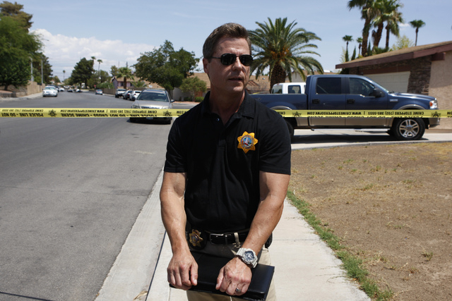 Las Vegas police Sgt. John Sheahan speaks to the media at the scene of a home invasion and shooting at the corner of Autumn Street and Rollingwood Drive in Las Vegas Tuesday, July 29, 2014. A home ...