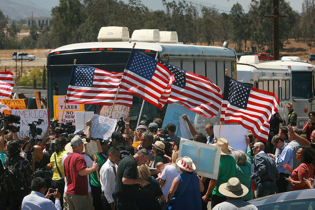 Protesters turn back three buses carrying 140 immigrants as they attempt to enter the Murrieta U.S. Border Patrol station for processing on Tuesday, July 1, 2014, in Murrieta, Calif. (AP Photo/The ...