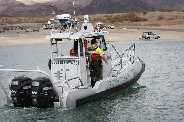 National Park Service rangers Patrick Knierman, right, and Elizabeth Dietzen head out and search for a missing swimmer at Lake Mead National Recreation Area near Las Vegas on Friday. (Jason Bean/L ...